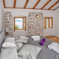 Bedroom 1. Amazing views out to sea. Note the revealed original stone walls. (Villa Ruza)