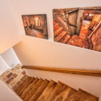 Stairs with gallery of photos of Villa Ruza prior to the renovation