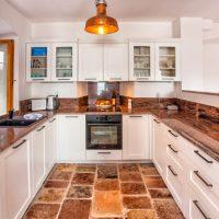 See the beautiful granite worktops and reclaimed marine light. (Villa Ruza)